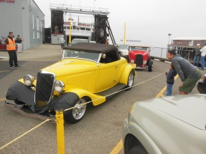One of many 1932 Ford coupes coming off the MV Coho