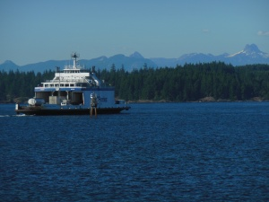Campbell River view of local ferry, Georgia Strait, and BC mountains on mainland