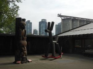 Granville Island juxtaposition; sculpture,grain elevators, highrises