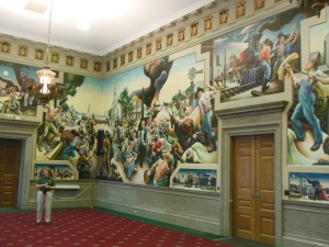 A portion of Thomas Hart Benton mural in the State Capital