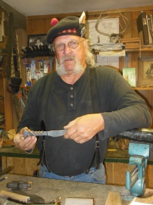 Knife maker using railroad spikes