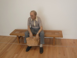 """Man on Bench"" sculpture by Duane Hanson at Crystal Bridges"