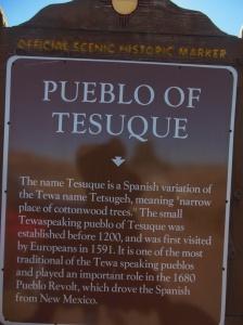 A marker about Tesuque Pueblo