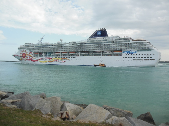 Norwegian Cruise Lines ship the Sun with pilot boat alongside it