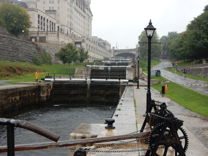 Ottawa locks on Rideau Canal with lock  worker in yellow slicker