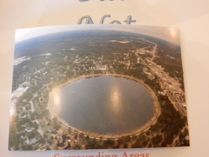 Postcard showing the round lake at DeFuniak Springs