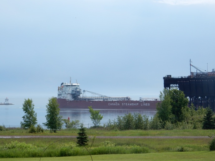 A lakes freighter loaded with taconite pellets heading east