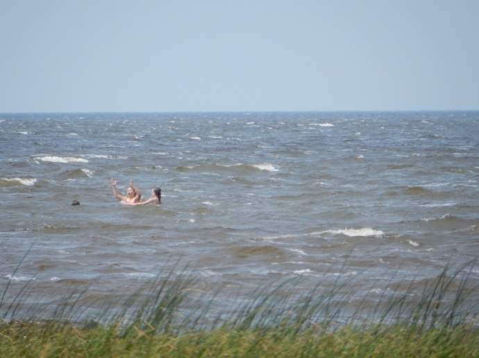 People swimming in Red Lake