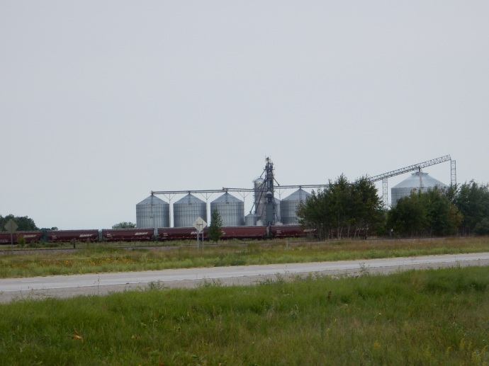 Silos,elevator and train along road
