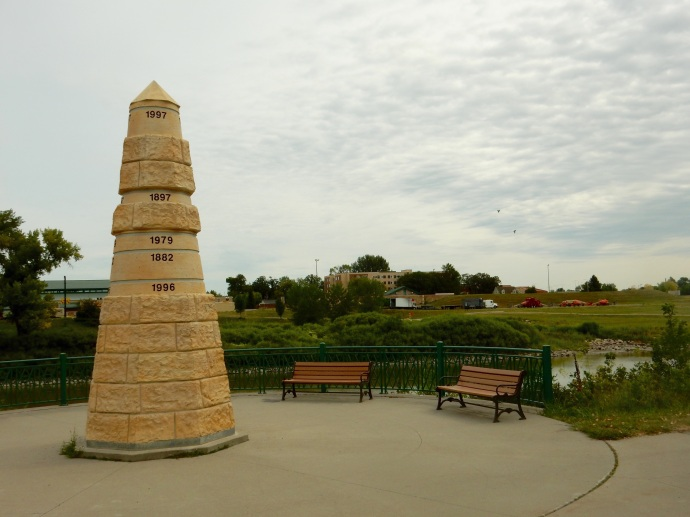 A memorial indicating the height of the past floods along the Red River