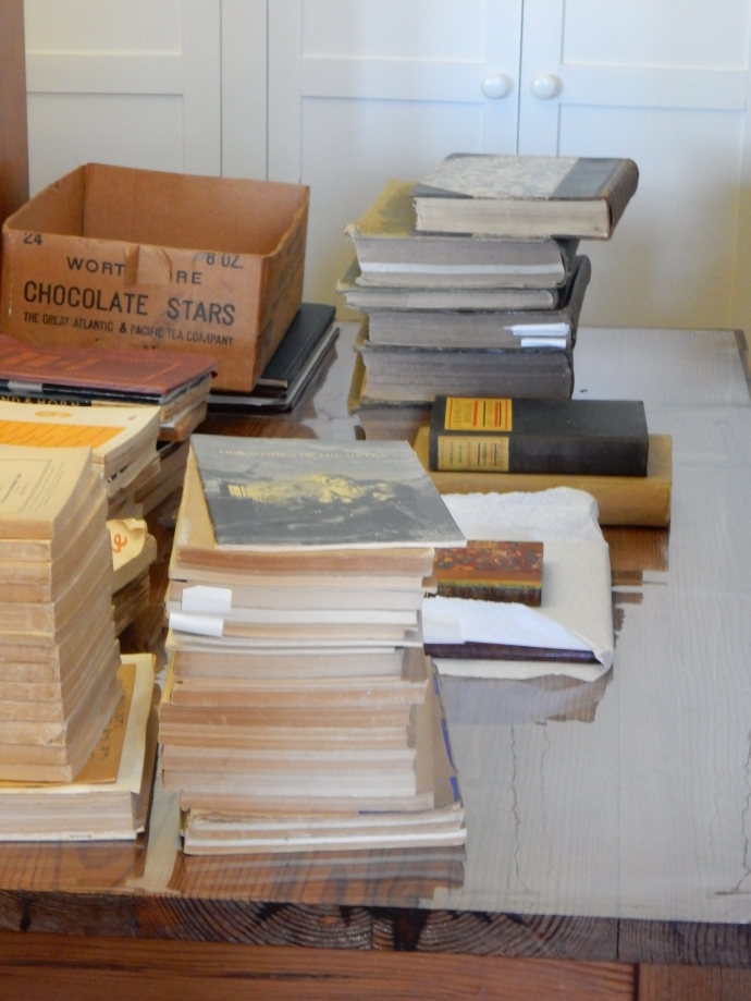 Some of the 17,000 books, note the slips of paper marking research items