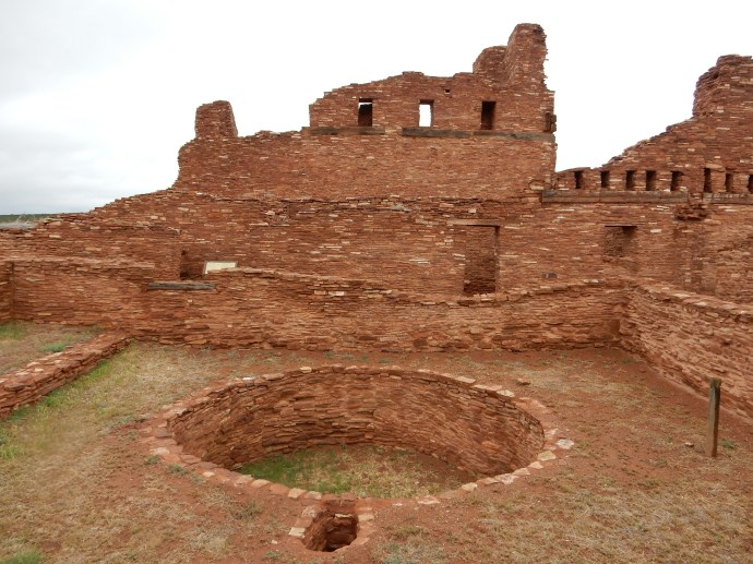 Abo mission ruins. Note the circular kiva in front of the church walls-did the Franciscans accept this Indian practice? Who knows?