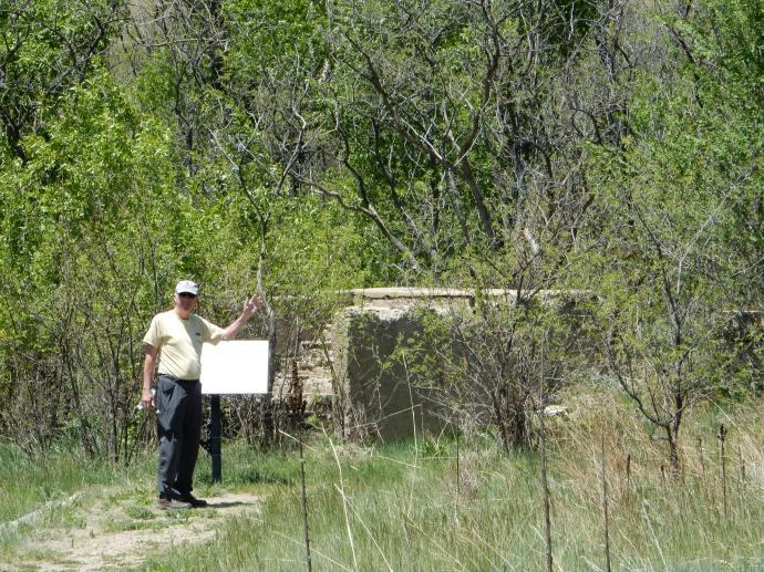Ed inspecting ruins at Sugarite Canyon State Park