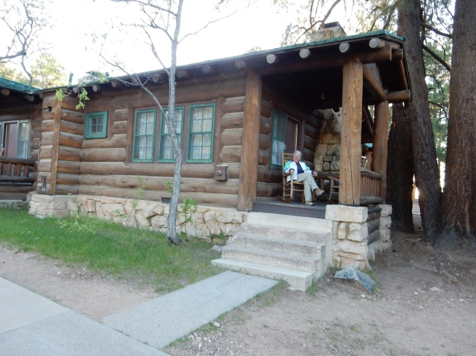 Chris on front porch of our cabin