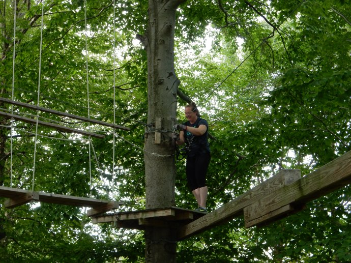 Deb climbing the aerial ropes
