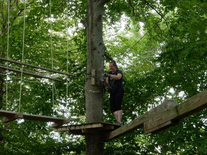 Deb climbing the aerial ropes