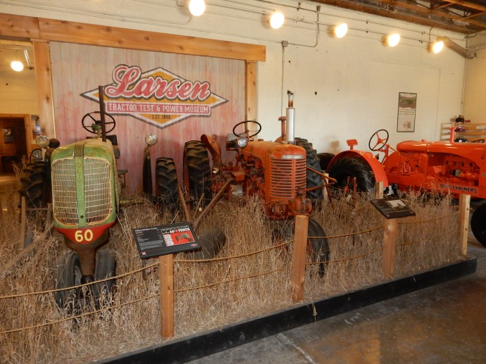 A scene at the tractor Test Museum depicting two unrestored tractors